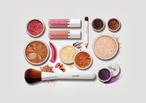 different types of makeup laid out on table